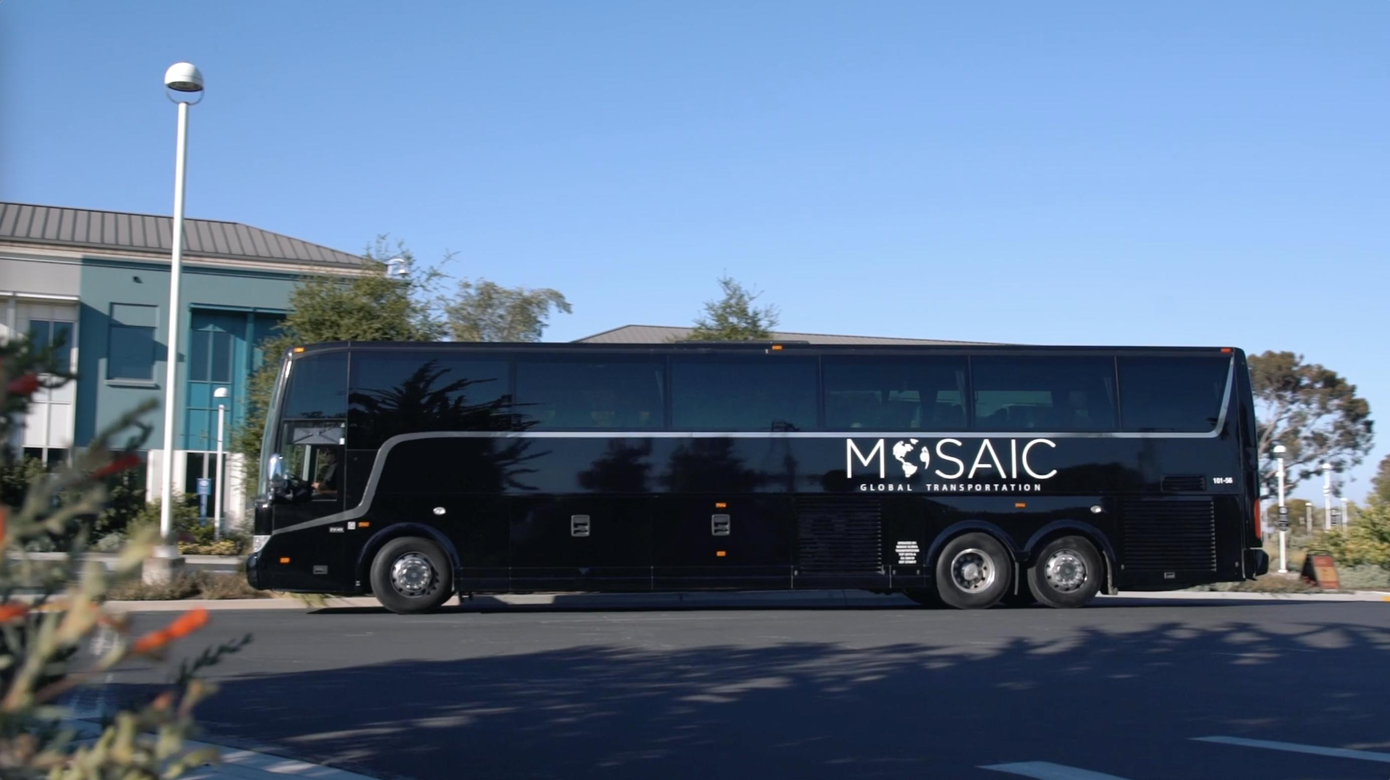 Large black shuttle bus parked on street