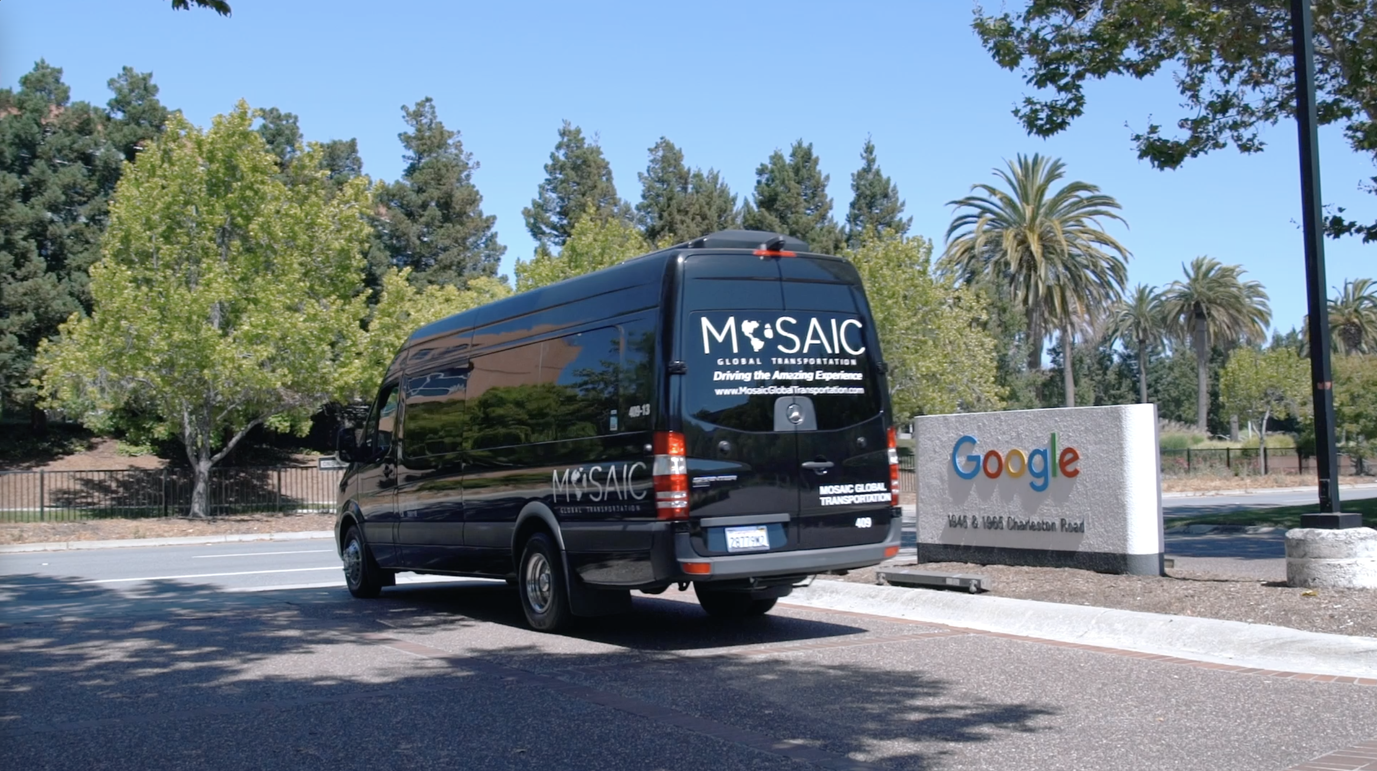 Mosaic Global Transportation van in front of a Google business sign